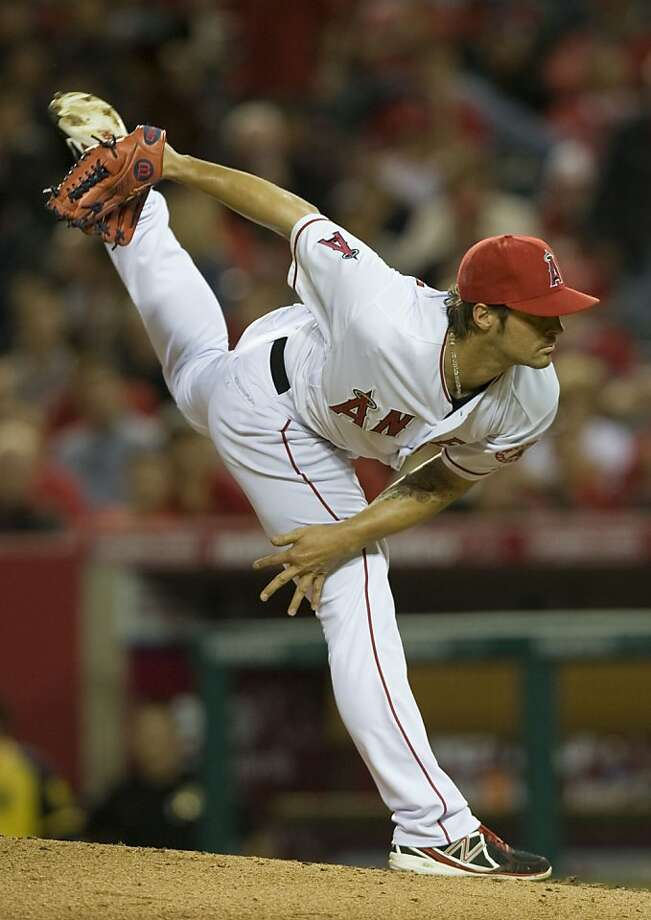 Los Angeles Angels starting pitcher C.J. Wilson throws against the Oakland Athletics in the second inning at Angel Stadium in Anaheim, California, on Tuesday, April 9, 2013. (Rose Palmisano/Orange County Register/MCT) Photo: Rose Palmisano, McClatchy-Tribune News Service
