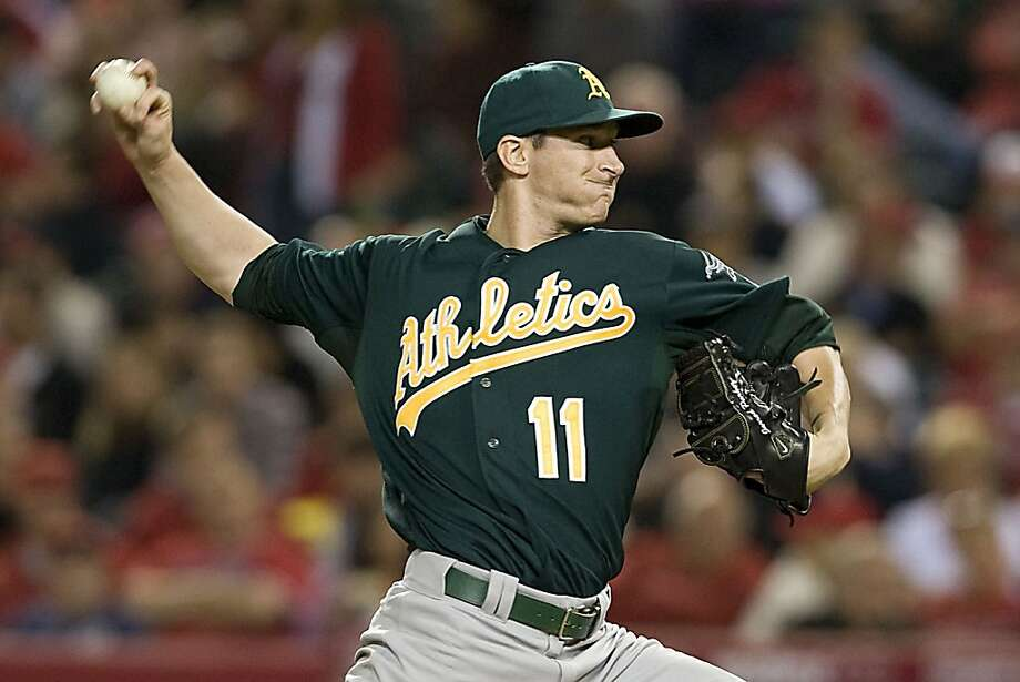 Oakland Athletics starting pitcher Jarrod Parker works against the Los Angeles Angels in the second inning at Angel Stadium in Anaheim, California, on Tuesday, April 9, 2013. (Rose Palmisano/Orange County Register/MCT) Photo: Rose Palmisano, McClatchy-Tribune News Service