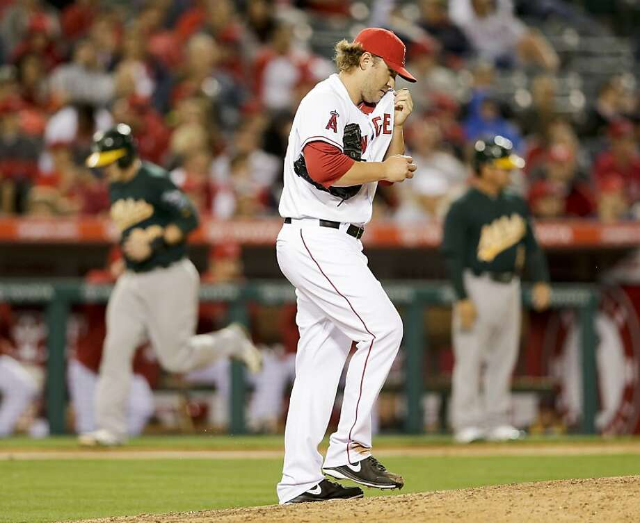 Los Angeles Angels relief pitcher Kevin Jepsen wipes his face after giving up a two-run home run to Oakland Athletics' Brandon Moss during the seventh inning of a baseball game in Anaheim, Calif. Tuesday, April 9, 2013. (AP Photo/Chris Carlson) Photo: Chris Carlson, Associated Press