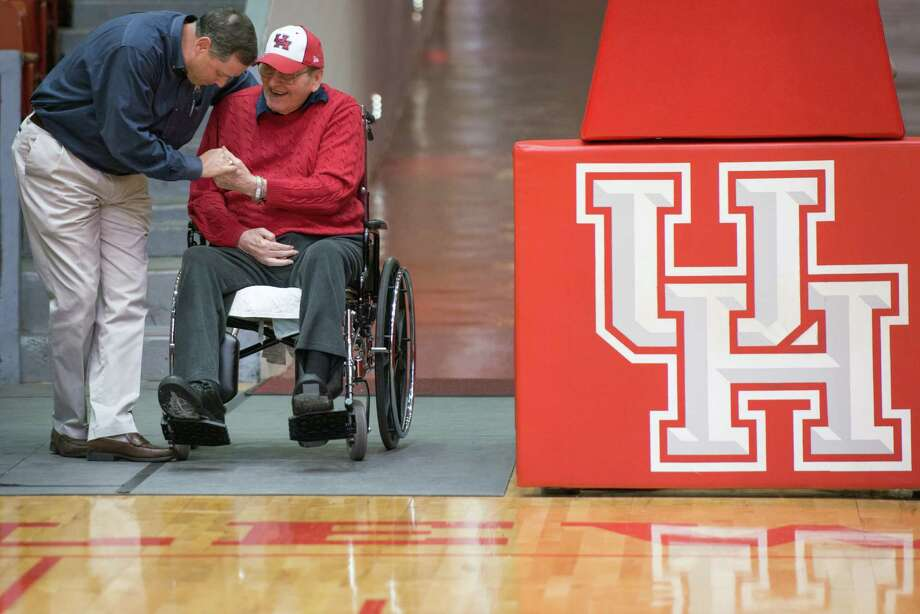 Former University of Houston basketball coach Guy V. Lewis is congratulated by Ralph Adams, a UH basketball manager from 80-84 and member of the board of directors of the Lettermen's Association, as he arrives for a press event at Hofheinz Pavilion on Tuesday, April 9, 2013, in Houston. Photo: Smiley N. Pool, Houston Chronicle / © 2013  Houston Chronicle