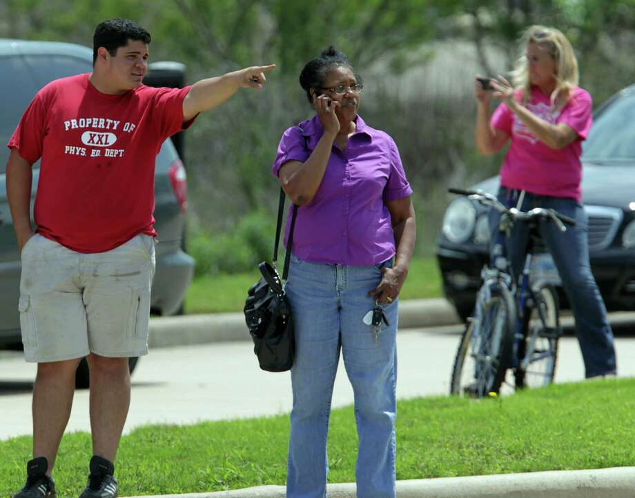 People wait just off the Lone Star College's Cypress-Fairbanks campus. Photo: James Nielsen, Houston Chronicle / © 2013 Houston Chronicle