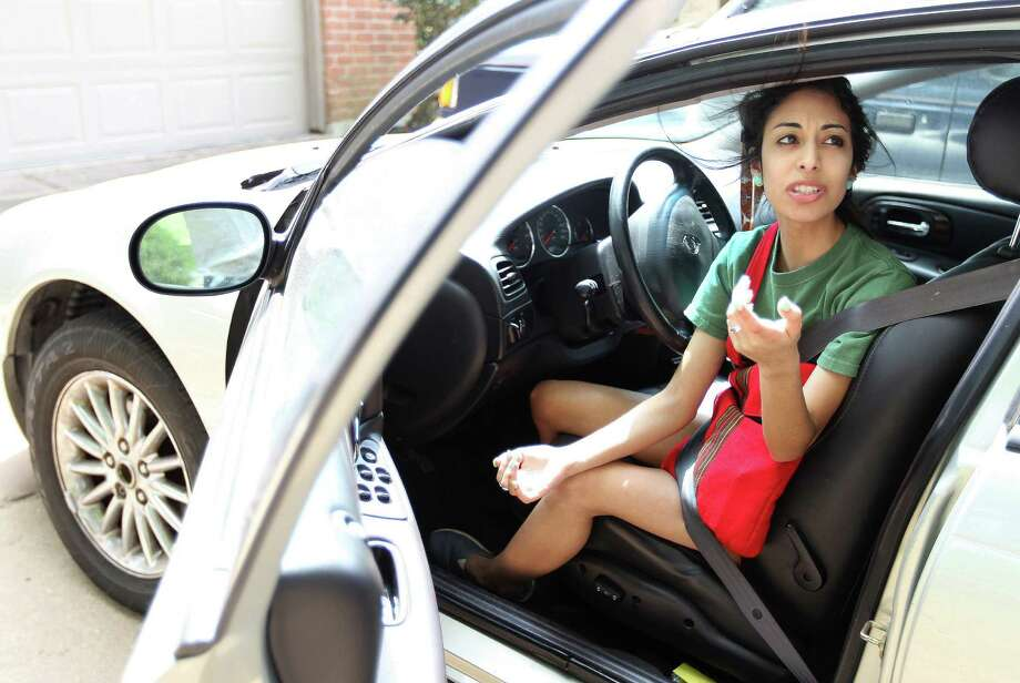 Jennifer Ramirez, 21 a student at Lone Star College, talks about living across the street from the suspect in the mass stabbings on campus, Tuesday, April 9, 2013, in Houston.  A student at Lone Star College's Cypress-Fairlbanks campus, Dylan Quick, was reported to have stabbed at least 14 people were a mass stabbing at the  Cypress-Fairlbanks campus. Photo: Karen Warren, Houston Chronicle / © 2013 Houston Chronicle