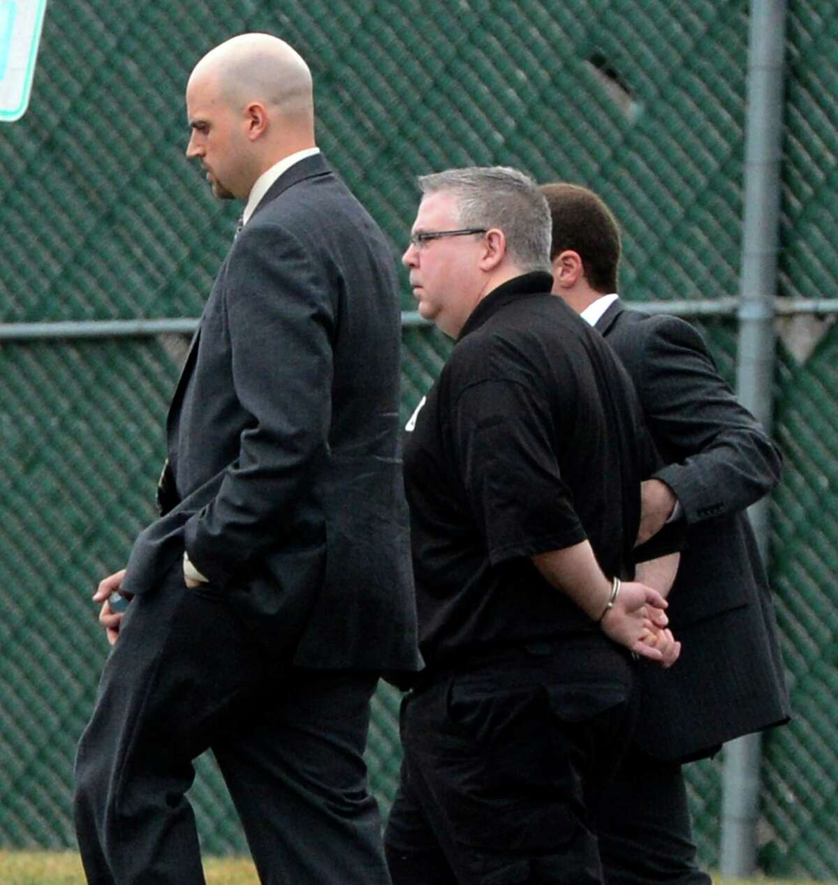Albany County corrections officer James Cerniglia is escorted out of Albany County Jail after being arrested Wednesday morning in April 10, 2013, in Colonie, N.Y. Cerniglia is accused of running a Capital Region bookmaking ring in which bets and payoffs were routinely taking place at the jail. (Skip Dickstein/Times Union)