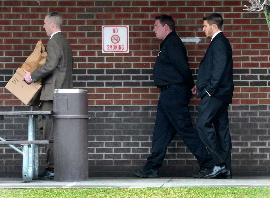 Albany County sheriff's employees arrest Albany County sheriff's employees last week. Corrections officer Timothy Robillard is escorted out of the county Jail after being arrested Wednesday morning, April 10, 2013. Robillard is accused of running a Capital Region bookmaking ring in which bets and payoffs were routinely taking place at the jail. (Skip Dickstein/Times Union) Photo: SKIP DICKSTEIN