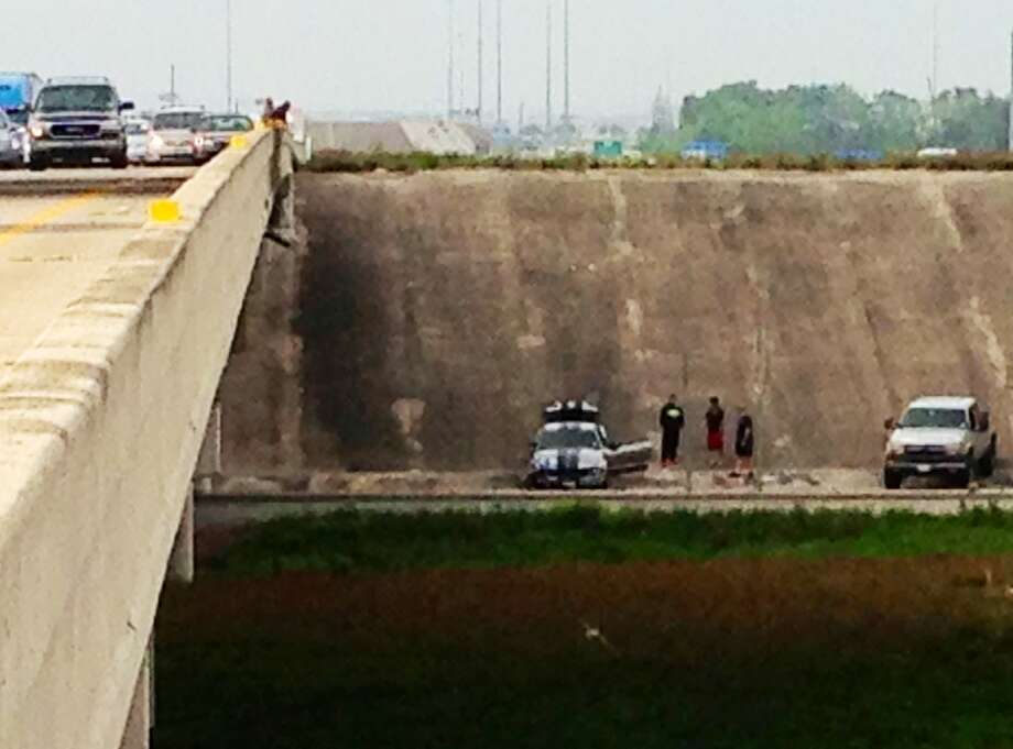 A Ford Mustang crashed into a culvert near the intersection of Hwy. 288 and the Beltway in Houston. (Francisca Ortega)