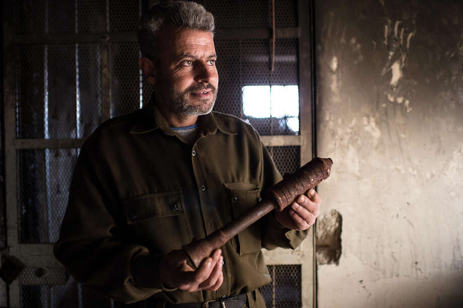 A man holds a piece of a hand made missile that he produces in a secret factory on January 19, 2013 in Al-Bab, 30 kilometers from the northeastern Syrian city of Aleppo. Recycled or non exploded bombs collected after shellings are used for the manufacturing and sugar as well for the propulsion. Each day, nearly 50 missiles are assembled for the Abu baker Brigade. Photo: AFP, AFP/Getty Images / 2013 AFP