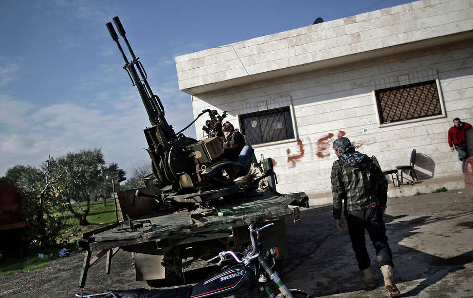 In this Friday, Dec. 14, 2012 photo, a Syrian rebel checks an anti-aircraft weapon, in Maaret Misreen, near Idlib, Syria. The new Syrian rebel chief, a defected army general who spent months in exile, says he has begun operating inside Syria to unite autonomous anti-regime militias for what he hopes will be the final push against President Bashar Assad. Photo: Muhammed Muheisen, ASSOCIATED PRESS / AP2012