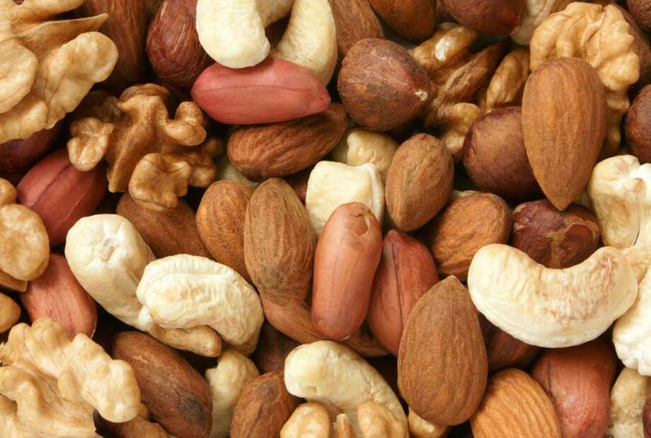 "Many varieties, including walnuts, hazelnuts, almonds, pine nuts, Brazil nuts and peanuts, contain the essential amino acid l-arginine, which helps the brain do its job circulating neurotransmitters, brain chemicals that send messages to cells (like, ""gee, this feels so good—more please!""). ""And the fatty acids in nuts increase endorphins, making you feel more relaxed,"" says Balleck. L-arginine also has been shown to dilate blood vessels, improving blood flow to the genitals, which in turn may enhance arousal and intensify orgasms. Photo: Olga Popova, Getty Images"