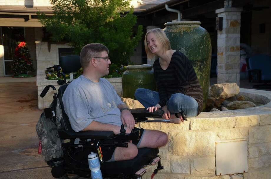 Sgt. Ed Matayka spends a quiet moment with his wife, Karen, at the Warrior and Family Support Center near San Antonio Military Medical Center. The Vermont National Guard medic lost both legs and suffered a brain injury after a roadside bomb blew up his vehicle in Afghanistan, in July 2010. Photo: Lori Newman / U.S. Army