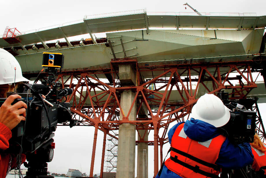 News media at Pier E-2 of the new eastern section of the Bay Bridge which contains the fractured anchor rods, as CalTrans conducts a boat tour of the impacted areas of new eastern section of the Bay Bridge on Wednesday Mar. 27, 2013, in Oakland. Inspections found that 30 large bolts on the new eastern span of the Bay Bridge have fractured. Photo: Michael Macor, The Chronicle / ONLINE_YES