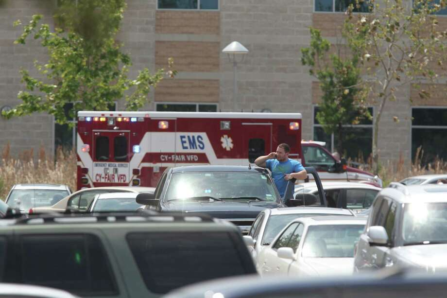 Students wait to leave outside the Health Science Center in the Cy-Fair campus of Lone Star College where 14 people were wounded in a stabbing on Tuesday, April 9, 2013, in Cypress. Photo: Mayra Beltran, Houston Chronicle / © 2013 Houston Chronicle