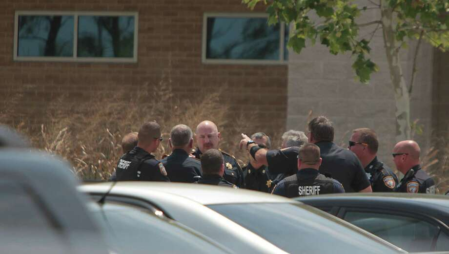 Harris County Sheriffs Officers organize outside the Health Science Center in the Cy-Fair campus of Lone Star College where 14 people were wounded in a stabbing on Tuesday, April 9, 2013, in Cypress. Photo: Mayra Beltran, Houston Chronicle / © 2013 Houston Chronicle