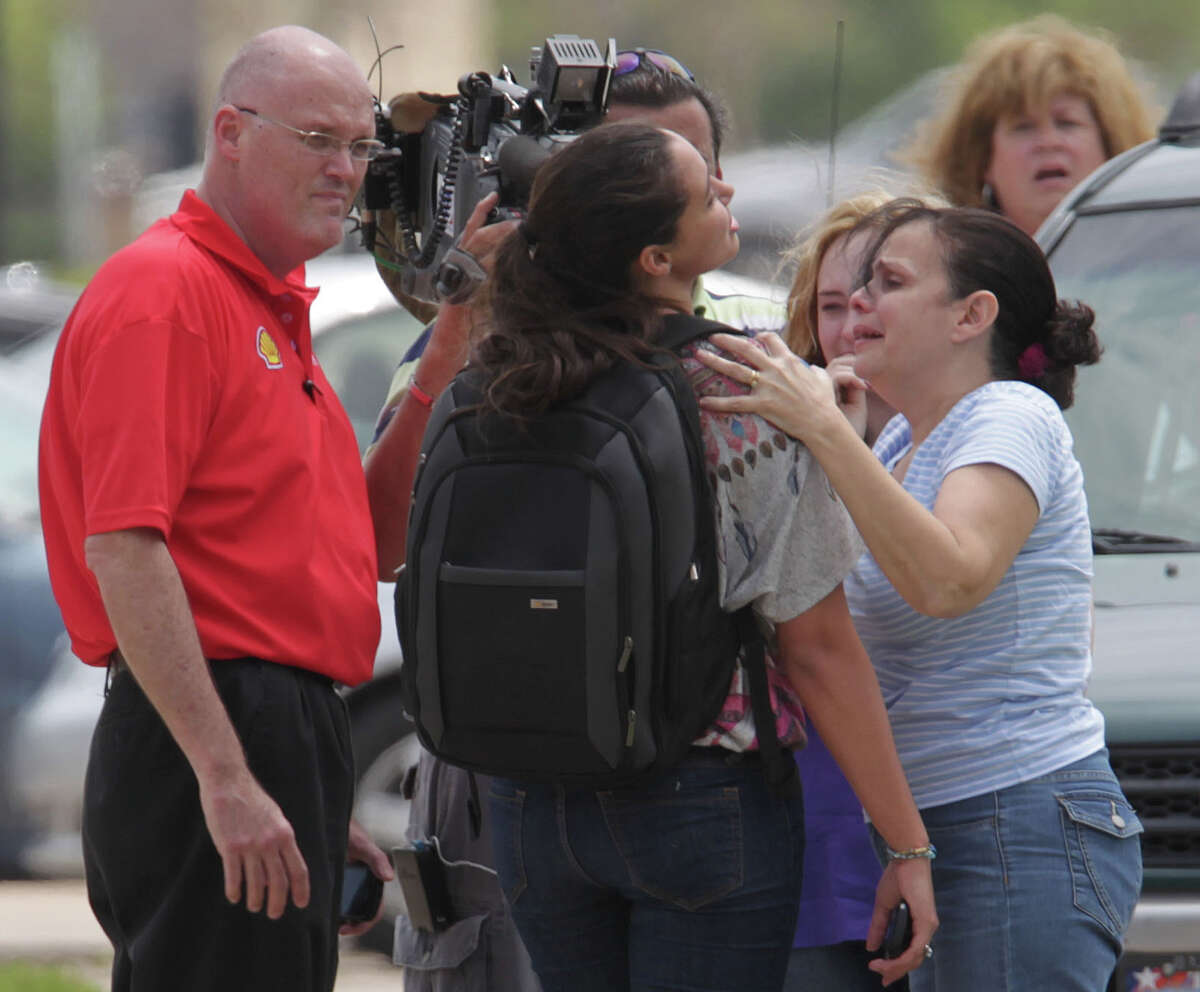 Michelle Alvarez, 2nd from right, is looked over by her aunt Elena Tokarew, right. Alvarez is a student at Lone Star College's Cypress-Fairbanks campus and was one of the injured in the stabbing attack at the campus. Authorities are reporting least 15 people were hurt in a stabbing at the campus Tuesday, April 9, 2013, in Cypress.