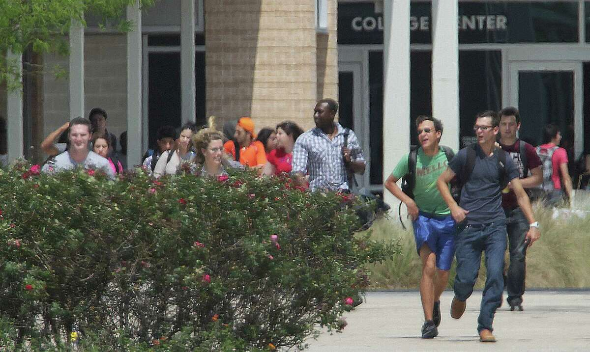 Students run from the Lone Star College's Cypress-Fairbanks campus.