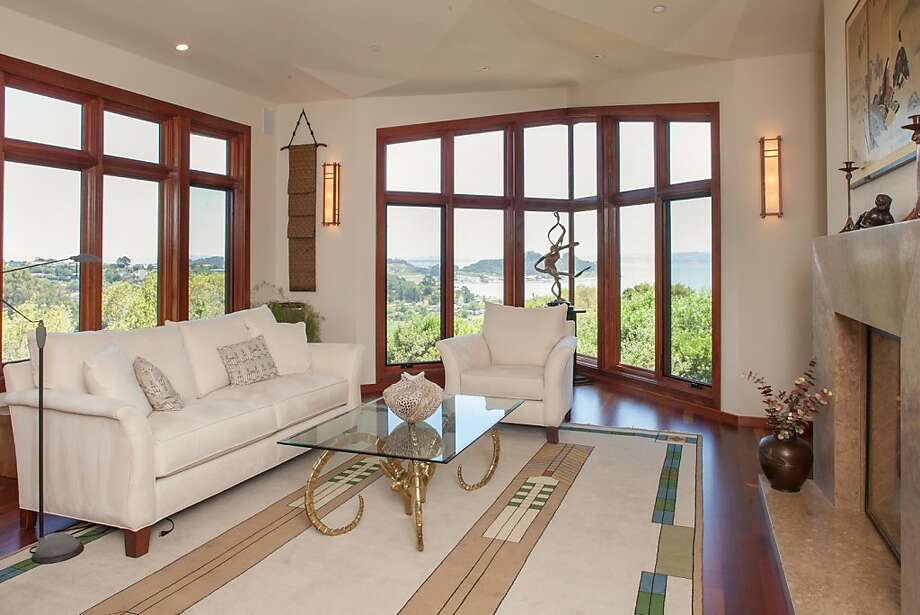 The living room at 226 Bayview Drive in San Rafael overlooks the bay and features a fireplace. Photo: Henley Photography