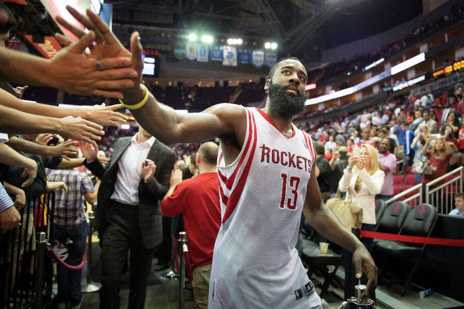 April 9: Rockets 101, Suns 98Houston Rockets guard James Harden high-fives fans as he leaves the court following a win over the the Phoenix Suns. Harden scored 33 point in the victory. Photo: Smiley N. Pool, Houston Chronicle / © 2013  Houston Chronicle
