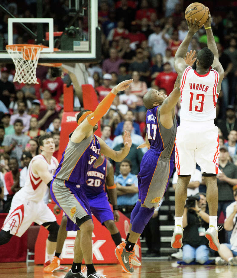 Rockets shooting guard James Harden (13) launches a 3-pointer at the buzzer over Phoenix Suns guard P.J. Tucker (17) that was ruled good via goaltending. Photo: Smiley N. Pool, Houston Chronicle / © 2013  Houston Chronicle