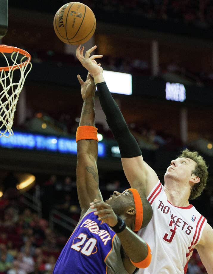 Rockets center Omer Asik reaches over Phoenix center Jermaine O\'Neal for one of his 22 rebounds . Photo: Smiley N. Pool, Houston Chronicle / © 2013  Houston Chronicle