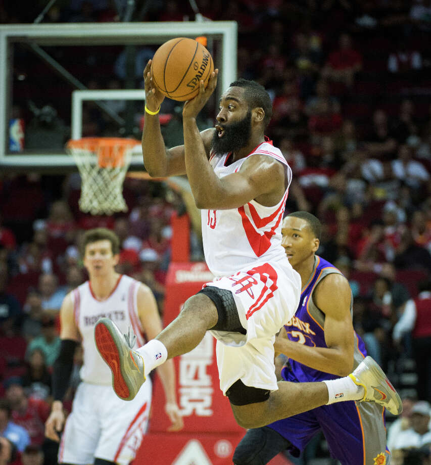 Rockets guard James Harden makes a pass after leaping for a loose ball. Photo: Smiley N. Pool, Houston Chronicle / © 2013  Houston Chronicle