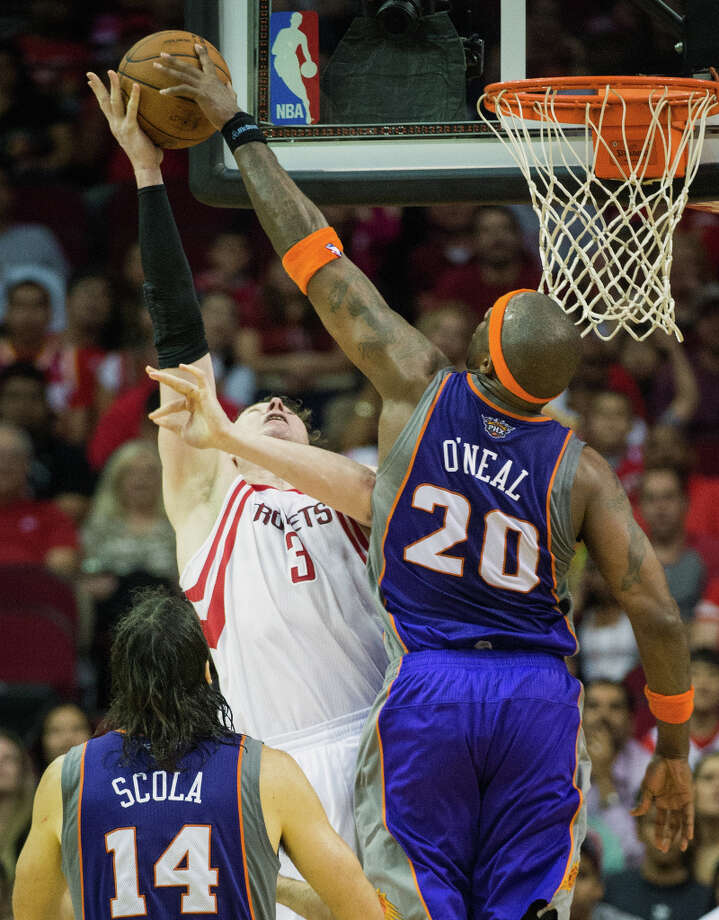 Suns center Jermaine O\'Neal blocks a shot by Rockets center Omer Asik. Photo: Smiley N. Pool, Houston Chronicle / © 2013  Houston Chronicle