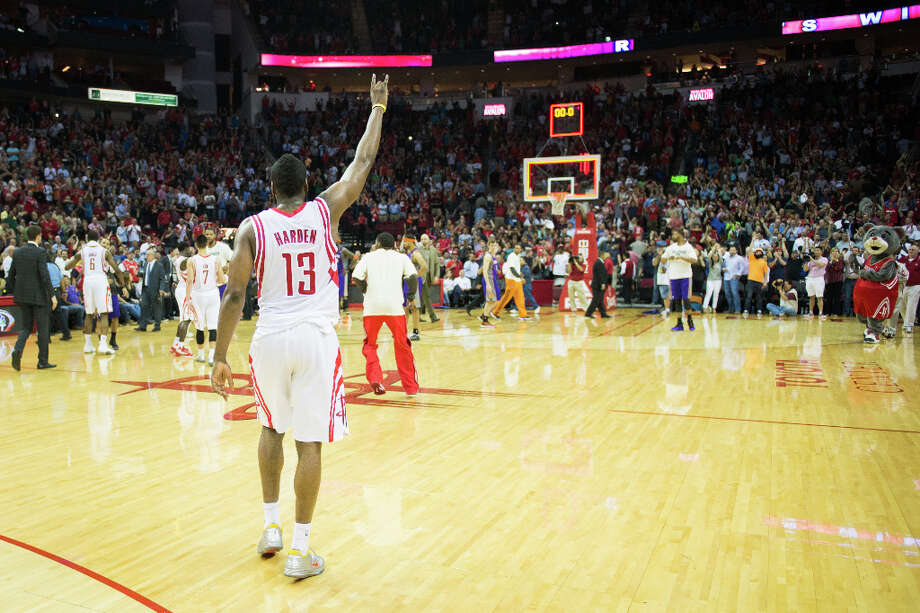 Rockets guard James Harden celebrates after the victory over the Suns. Photo: Smiley N. Pool, Houston Chronicle / © 2013  Houston Chronicle