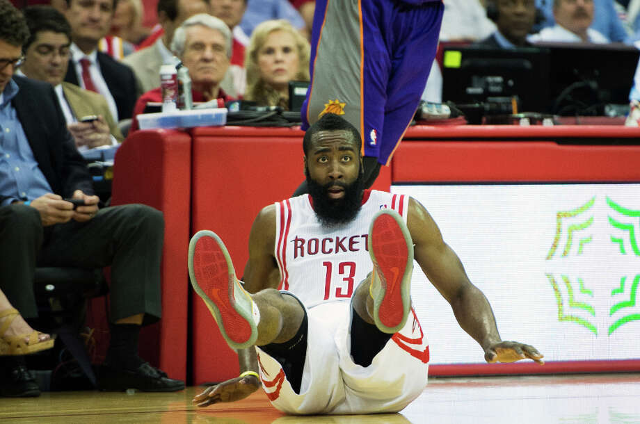 Rockets guard James Harden tumbles to the floor after taking a shot during the first half. Photo: Smiley N. Pool, Houston Chronicle / © 2013  Houston Chronicle