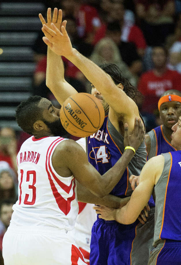 Rockets guard James Harden loses the ball as he collides Suns forward Luis Scola. Photo: Smiley N. Pool, Houston Chronicle / © 2013  Houston Chronicle