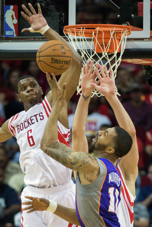 Rockets power forward Terrence Jones (6) defends against a shot by Suns power forward Markieff Morris (11). Photo: Smiley N. Pool, Houston Chronicle / © 2013  Houston Chronicle