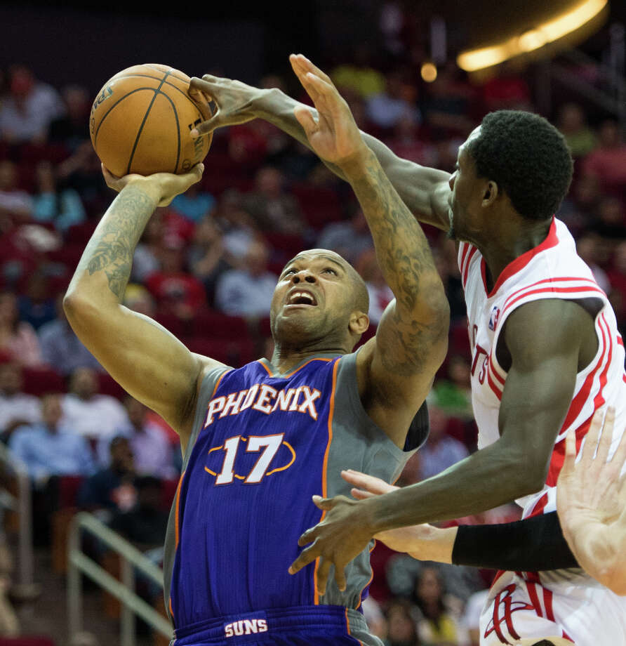 Rockets point guard Patrick Beverley blocks a shot by Suns guard P.J. Tucker. Photo: Smiley N. Pool, Houston Chronicle / © 2013  Houston Chronicle