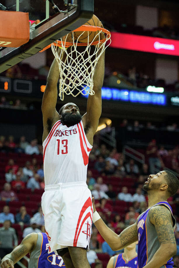 Rockets guard James Harden goes up for a dunk during the first half. Photo: Smiley N. Pool, Houston Chronicle / © 2013  Houston Chronicle