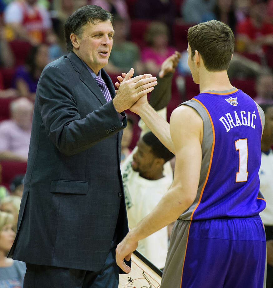 Rockets head coach Kevin McHale shakes hands with Suns point guard Goran Dragic, a former Rockets player, before the game. Photo: Smiley N. Pool, Houston Chronicle / © 2013  Houston Chronicle