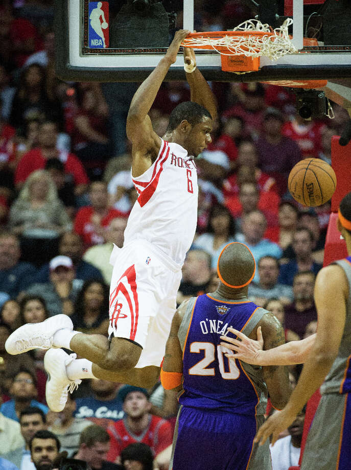 Rockets power forward Terrence Jones dunks the ball past Suns center Jermaine O'Neal. Photo: Smiley N. Pool, Houston Chronicle / © 2013  Houston Chronicle