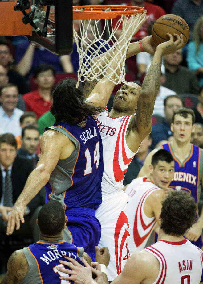 Rockets forward Greg Smith is fouled by Phoenix forward Luis Scola. Photo: Smiley N. Pool, Houston Chronicle / © 2013  Houston Chronicle