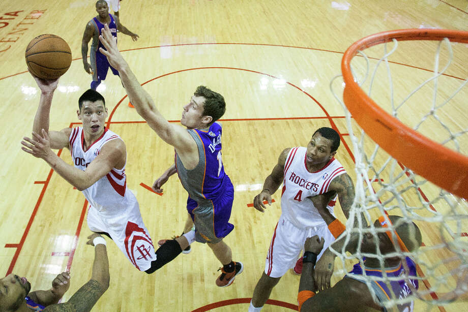 Rockets point guard Jeremy Lin puts up a shot as Suns point guard Goran Dragic defends. Lin scored 13 points. Photo: Smiley N. Pool, Houston Chronicle / © 2013  Houston Chronicle