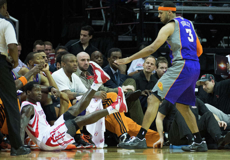 Rockets point guard Patrick Beverley is knocked into the Suns bench by guard Jared Dudley (3). Photo: Smiley N. Pool, Houston Chronicle / © 2013  Houston Chronicle