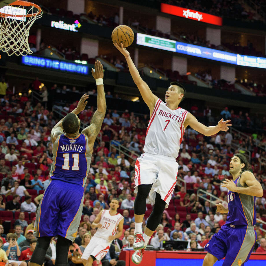 Rockets point guard Jeremy Lin puts up a shot over Suns power forward Markieff Morris. Photo: Smiley N. Pool, Houston Chronicle / © 2013  Houston Chronicle