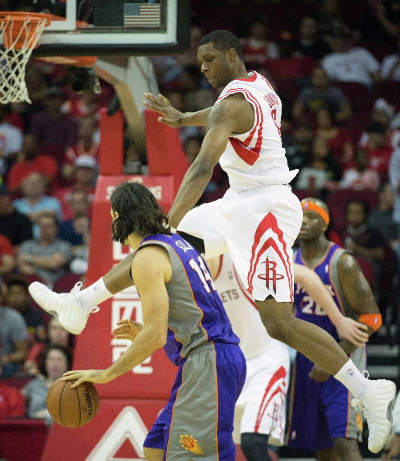 Rockets forward Terrence Jones defends against Suns power forward Luis Scola. Photo: Smiley N. Pool, Houston Chronicle / © 2013  Houston Chronicle