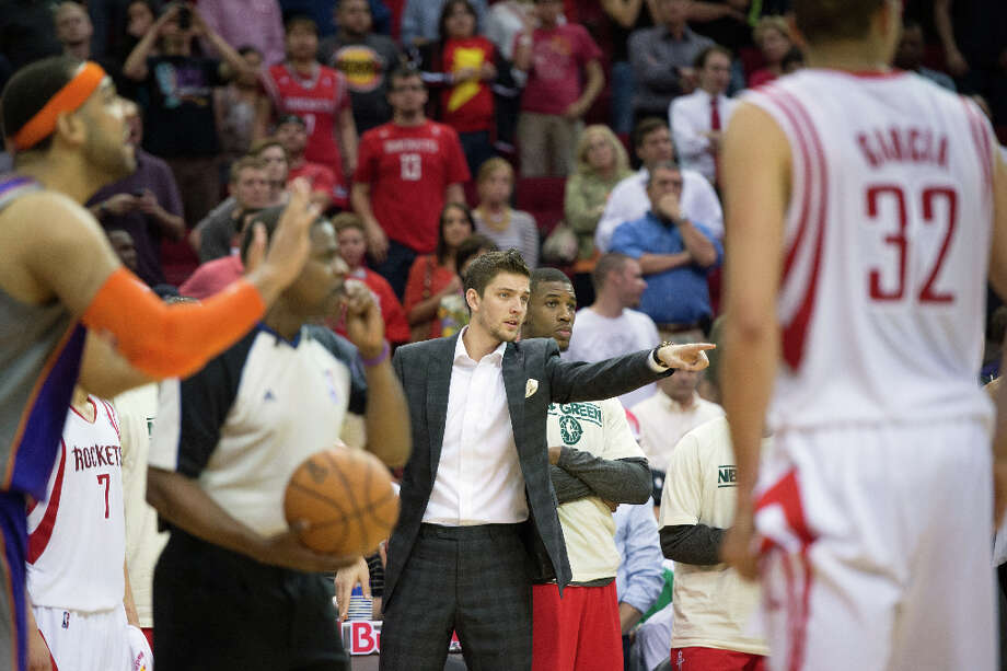 Rockets small forward Chandler Parsons watches from the bench. Photo: Smiley N. Pool, Houston Chronicle / © 2013  Houston Chronicle