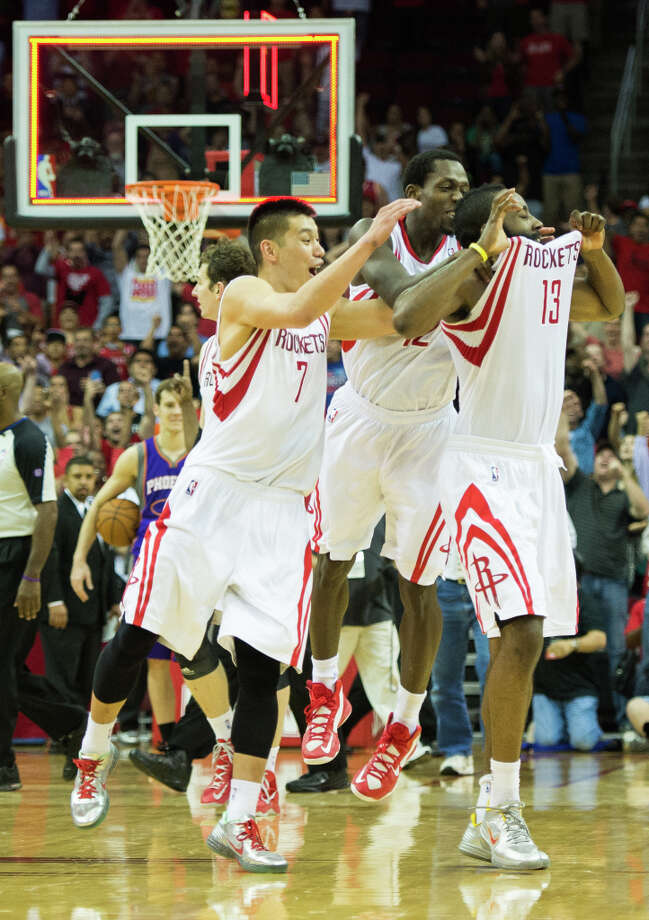 Houston Rockets guard James Harden, center, celebrates with Jeremy Lin, left, and Patrick Beverley after a goaltending call on Harden's 3-pointer at the buzzer gave the Rockets a victory over the Phoenix Suns. Photo: Smiley N. Pool, Houston Chronicle / © 2013  Houston Chronicle