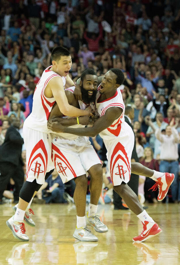 Houston Rockets guard James Harden, center, celebrates with Jeremy Lin, left, and Patrick Beverley after a goaltending call on Harden\'s 3-pointer at the buzzer gave the Rockets a victory over the Phoenix Suns. Photo: Smiley N. Pool, Houston Chronicle / © 2013  Houston Chronicle