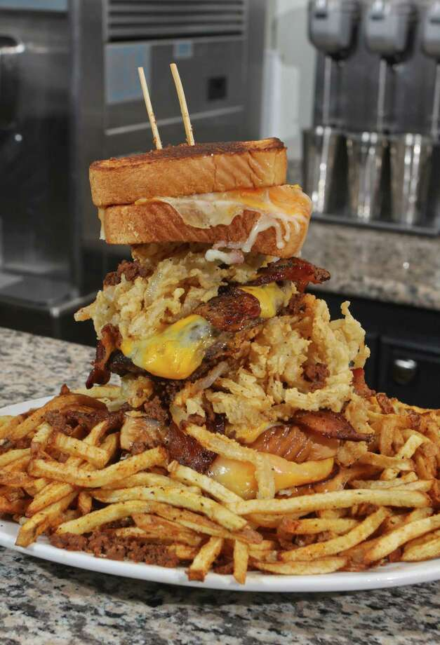 The Animal House sandwich at Ripps Grille features two 1/2-pound beef patties, chili, bacon and fried onion rings sandwiched between two grilled cheese sandwiches. Photo: Gary Fountain, Freelance / Copyright 2011 Gary Fountain