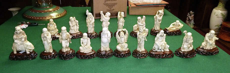 These 18 Chinese figurines valued at $30,000 were reported stolen from a Houston gallery on April 1. Homeland Security Investigations agents later seized them from a Houston auction house. Photo: Homeland Security