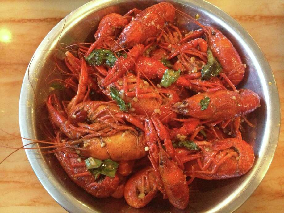 Cajun Kitchen makes Thai Basil Crawfish, which pairs the spicy flavors of Vietnamese-style crawfish with the bright flavors of Thai basil and lemongrass. Photo: Jenny Wang