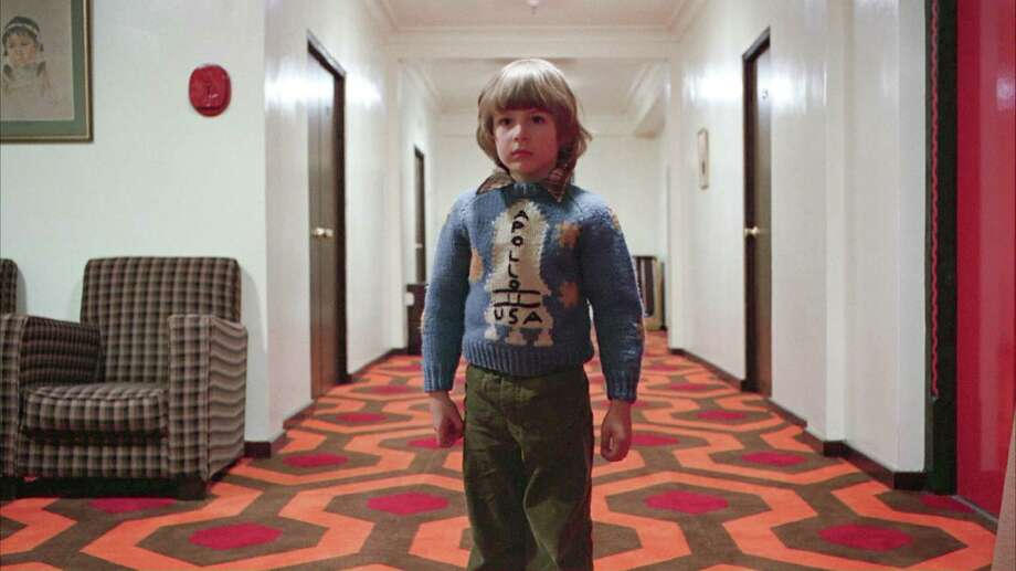 "In ""Room 237,"" one filmmaker claims that the Apollo 11 sweater worn by Danny Lloyd, who starred as Danny Torrance in Stanley Kubrick's film ""The Shining,"" was a reference to a faked-moon-landing theory. Photo: WARNER BROTHERS, HO / WARNER BROTHERS"