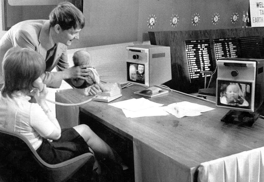 Dec. 12, 1971: A happy couple awkwardly holds their baby so grandparents in Sweden can see him. I\'m guessing this videophone call cost about $45 per minute in 1971. Now excuse me while I give my iPhone a hug. / ONLINE_YES