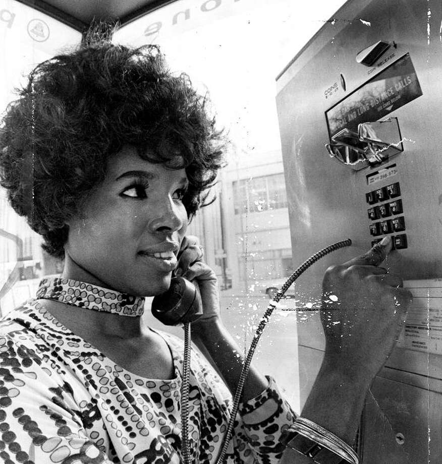 Feb. 11. 1972: Charlotte Love calls from the first touch tone pay phone installed in San Francisco. I\'ll admit to a little crush on Ms. Love. Remember when SF residents actually made an effort to look nice when they went outside? / ONLINE_YES