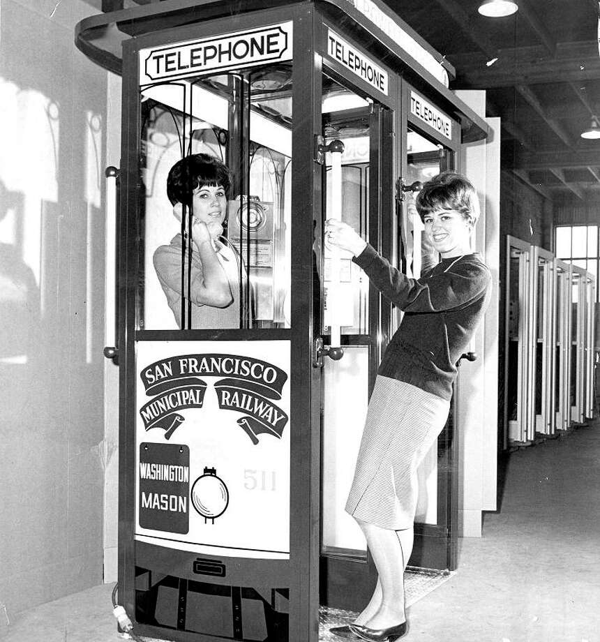 May 31, 1966: Karen Sutherland and Sharon Thatcher model the new cable car-shaped phone booths in San Francisco. I want one of these as a planter. / ONLINE_YES