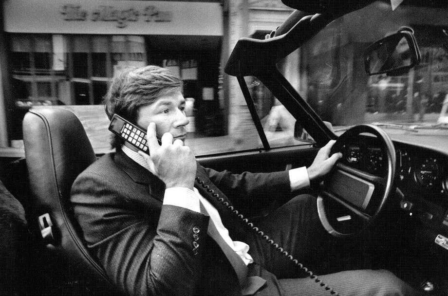 Sept. 28, 1987: Investment banker Michael Yancey uses a cellular car phone in his Porsche while driving through SF -- completely unaware that this would become illegal 25 years later, and The Magic Pan would go out of business. Photo: Steve Ringman, The Chronicle / ONLINE_YES