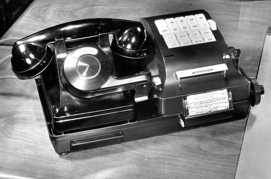 """April 15, 1951: This is the amazing Dialaphone, which was a precursor to touch tone phones. Described in the press release as \""""compact and attractive,\"""" it could dial pre-programmed numbers by cutting perforations in tape. / ONLINE_YES"""