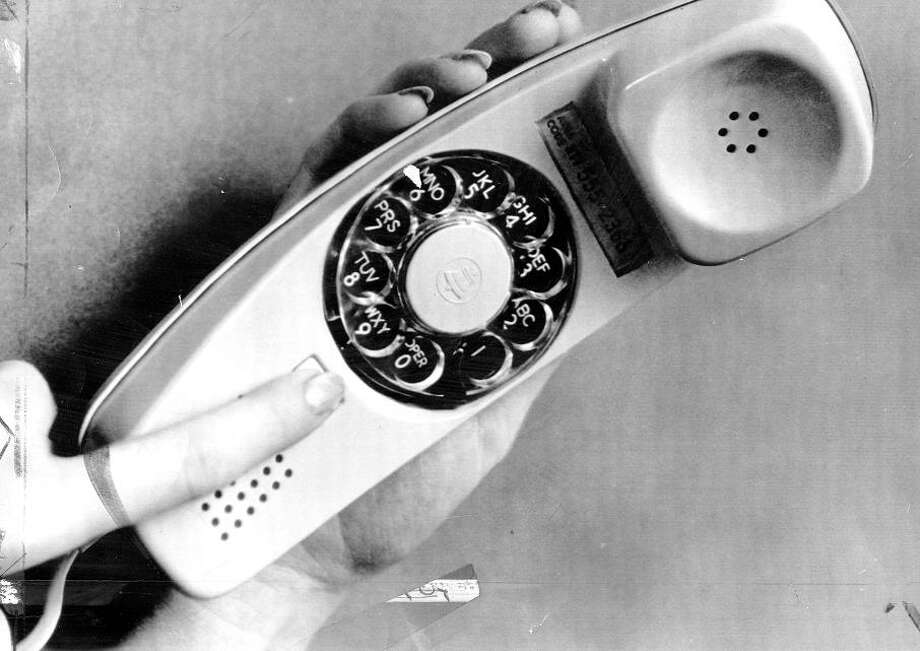 "Nov. 6, 1971: Behold the Bell Systems Trimline -- a telephone that had the rotary dialer in the handset! When people saw these amazing phones, I\'m sure they were thinking ""Butler robots must only be a year or two away.\"" Photo: UPI / ONLINE_YES"